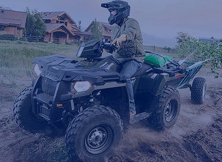 Person Riding Green Polaris ATV